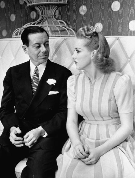 Cole Porter in a suit with his wife